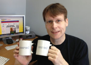 Paul Morrow, designer of the first Baybayin font, and the mug he created for us